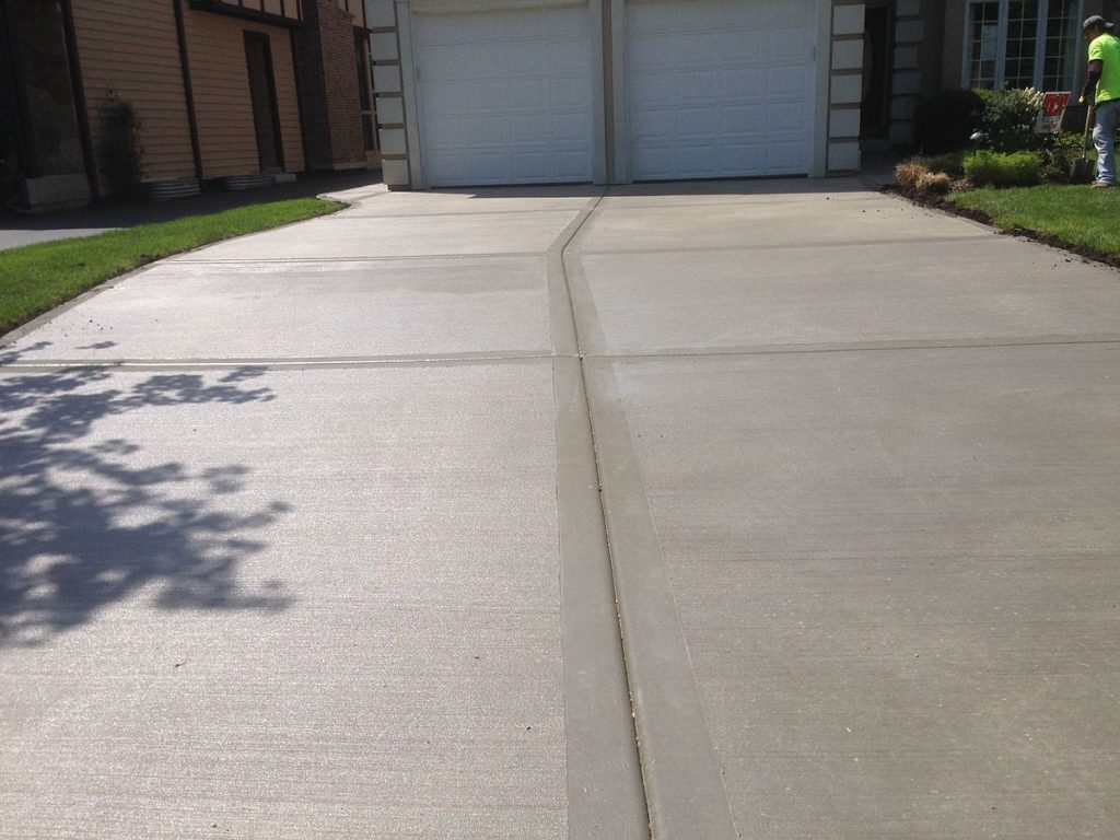 A picture of a recently refinished driveway.